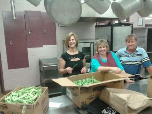 Ithaca City School District Central Kitchen employees with locally grown green beans